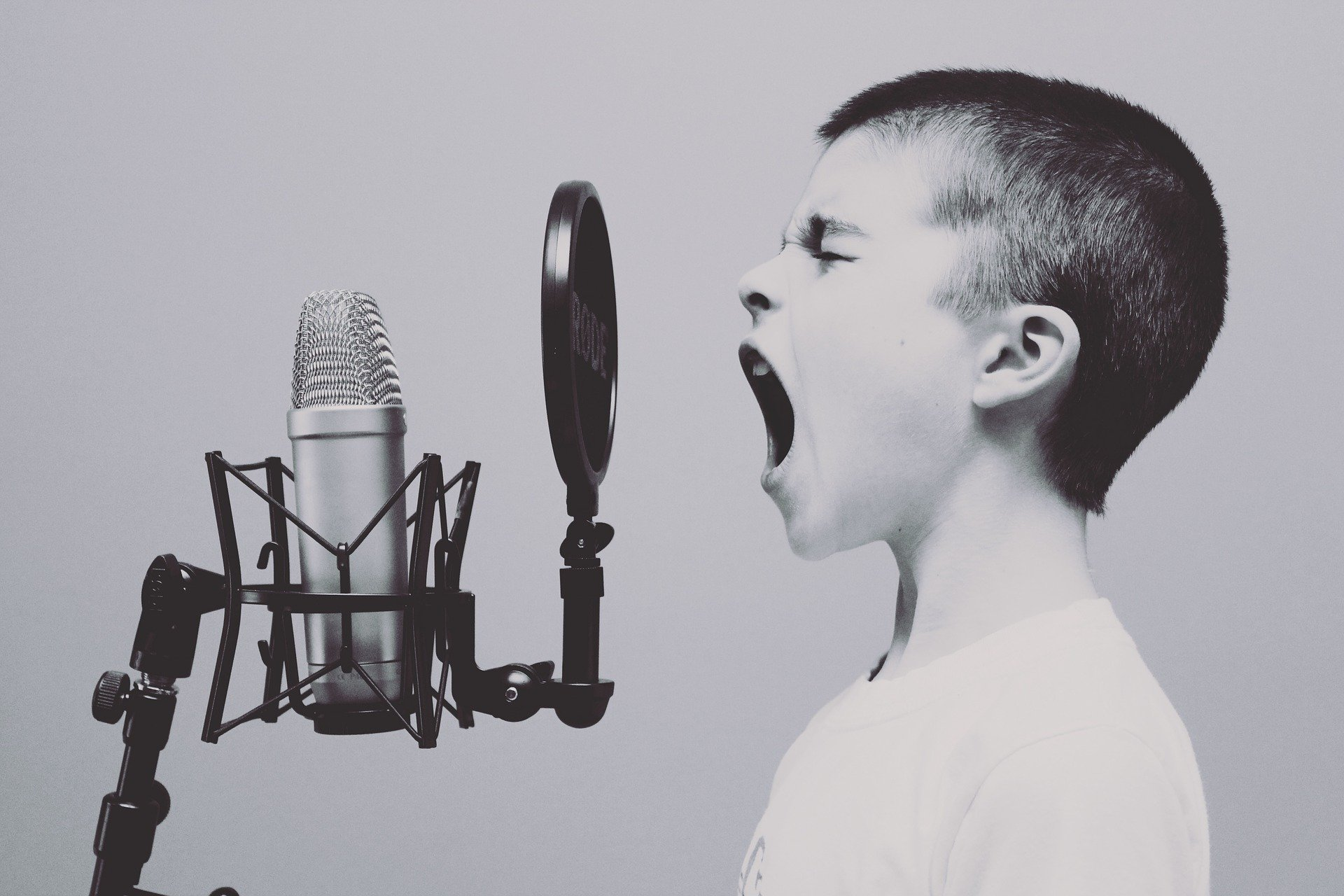 Boy Shouting In Microphone
